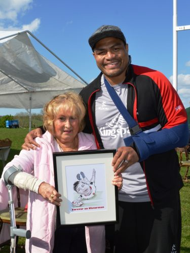 "... and Rithie Kohner presented him with a Stan D'Upp caricature ,""FOREVER AN ULSTER MAN"""